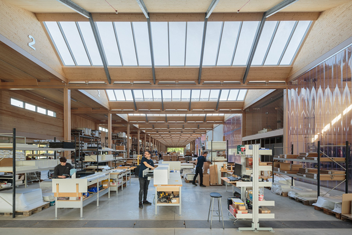 How do VELUX Modular Skylights help to reduce running costs and carbon emissions of a building?