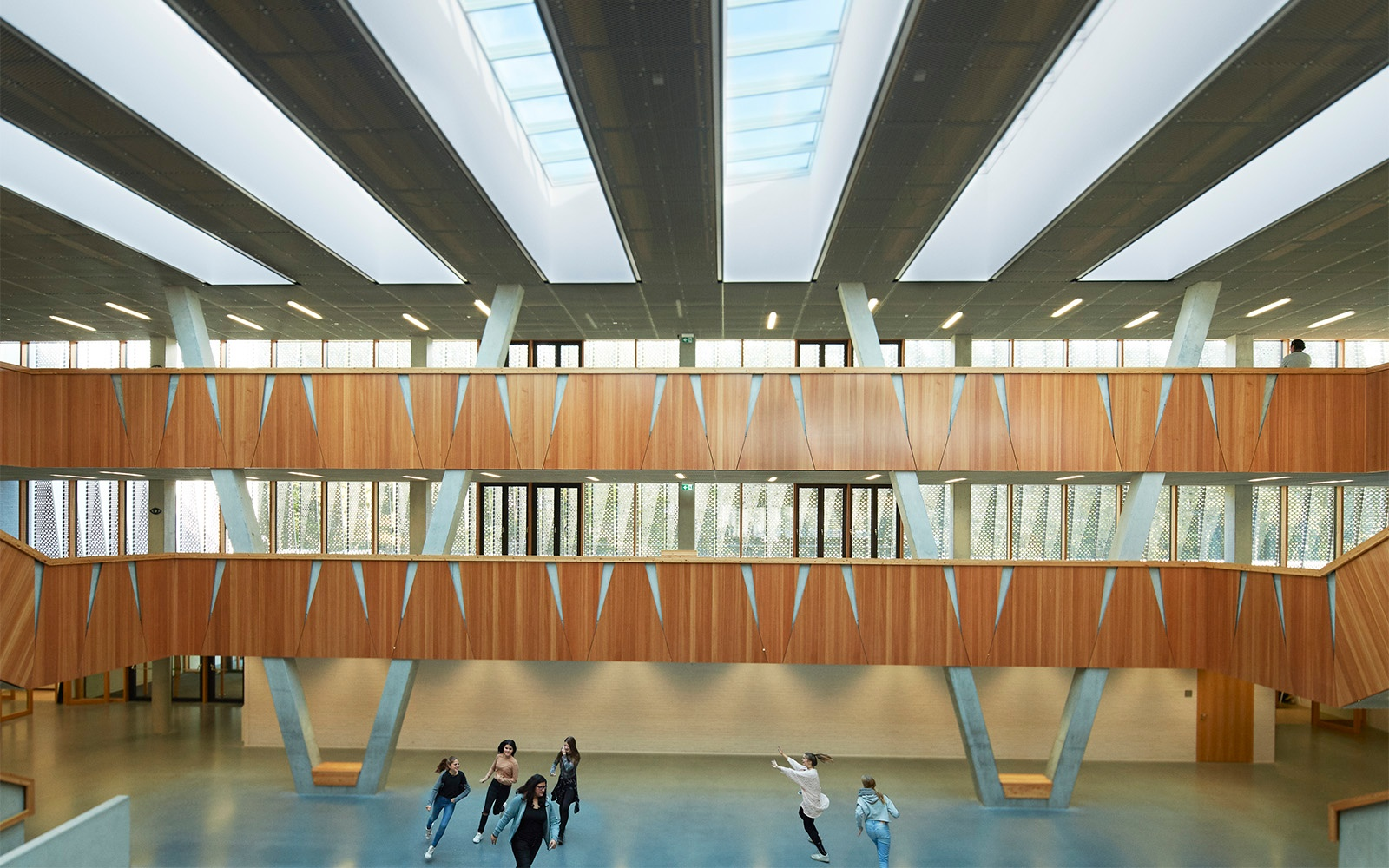 Open architectural school design with skylights for ventilation and natural lighting