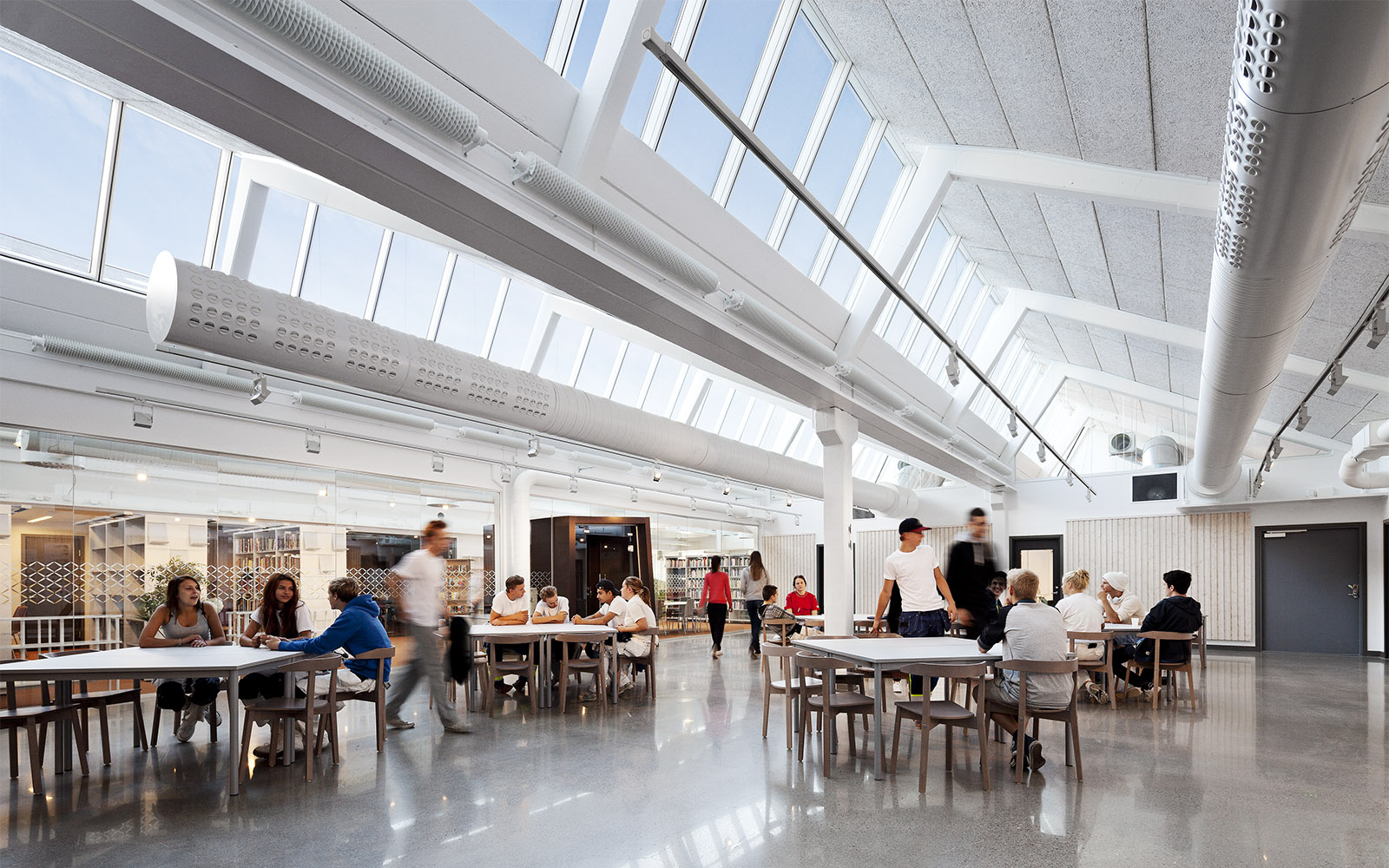 School cafeteria filled with natural light from overhead skylights