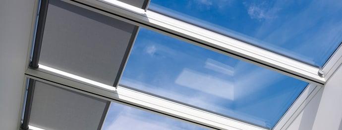 How do VELUX Modular Skylights deal with solar gain into the building?